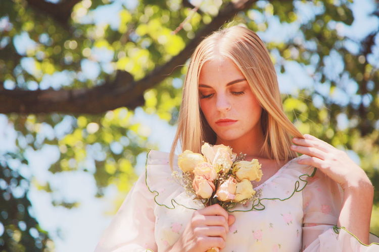 Girl with Roses Atmospheric Mood Beautiful Girl Blonde Girl Flower Front View Headshot Holding Idyllic Innocence Outdoors Person Portrait Pretty Girl Retro Style Roses Softness Young Adult Young Women