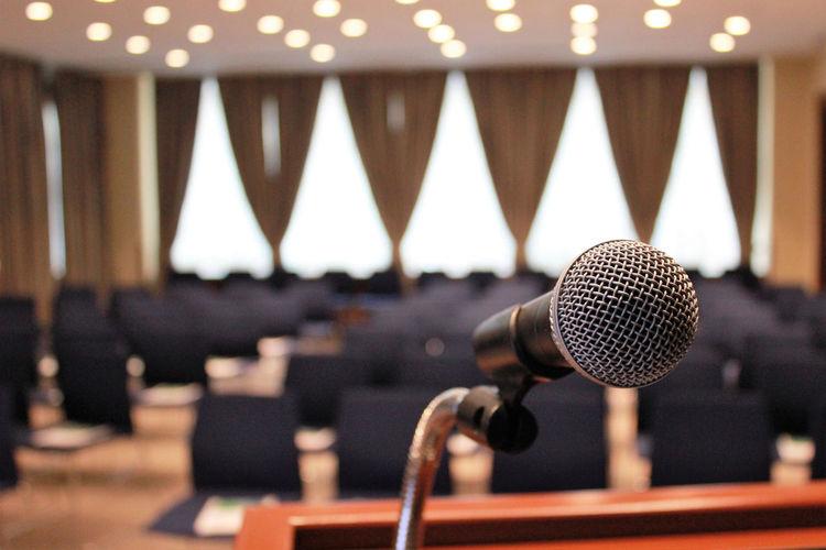 Close-up of microphone at auditorium