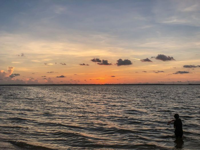 Sunset Sky Sea Water Beauty In Nature Scenics - Nature Cloud - Sky Orange Color Horizon Over Water Tranquility Real People Horizon Tranquil Scene Silhouette