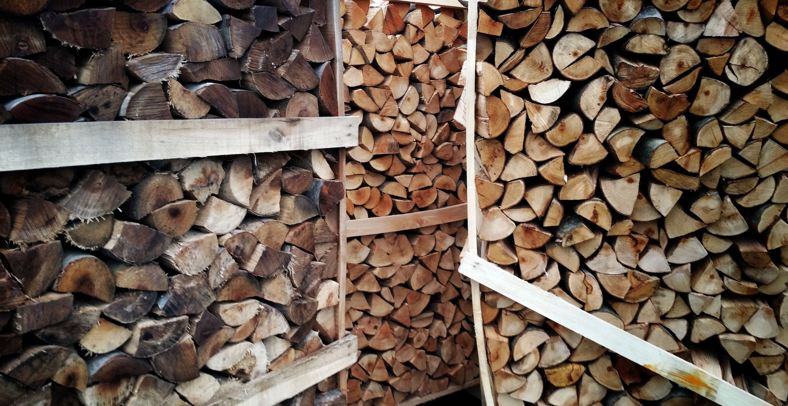 wood - material, firewood, large group of objects, log, stack, backgrounds, full frame, lumber industry, woodpile, deforestation, abundance, timber, wooden, forestry industry, textured, close-up, heap, repetition, brown, fossil fuel, day, outdoors, chopped, arrangement, no people, order, collection