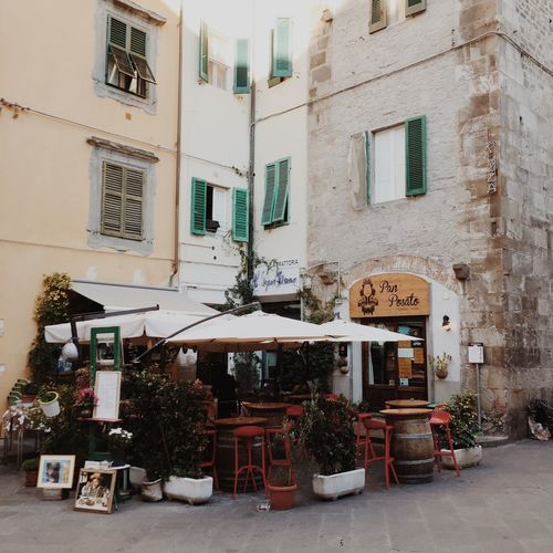 Restaurant in Pisa, Italy. Architecture Building Exterior Built Structure Day Illuminated IPhone IPhoneography Italy Mobilephotography No People Outdoors Pisa Square Streetphotography Table Travel Destinations Tree Tuscany