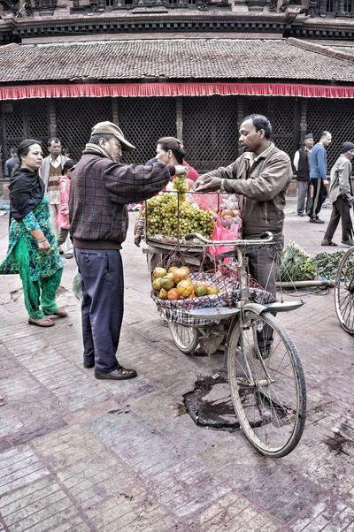 The Street Photographer - 2016 EyeEm Awards Nepal Vegetables People Nepali  Nepalese Streetphotography Kathmandu Street Outdoors ASIA Travel Woman Women Man Grape Bike Market Tangerine Fruit Selling