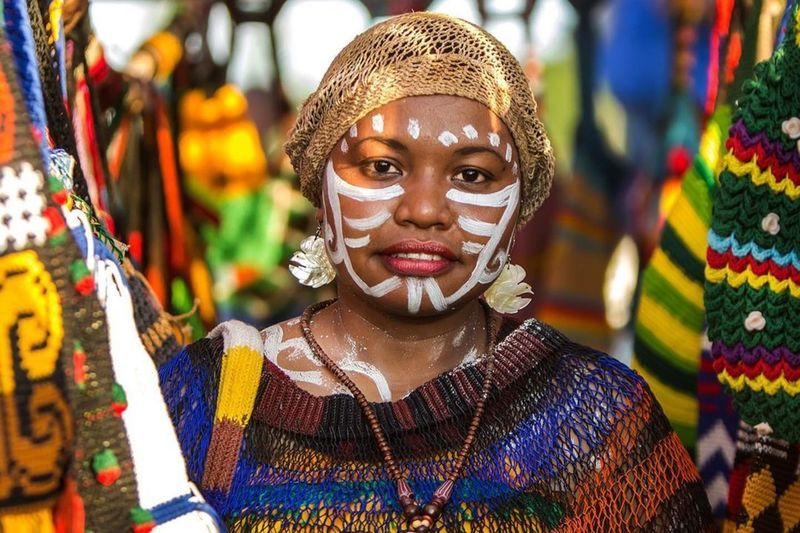 Portrait of woman with multi colored decoration