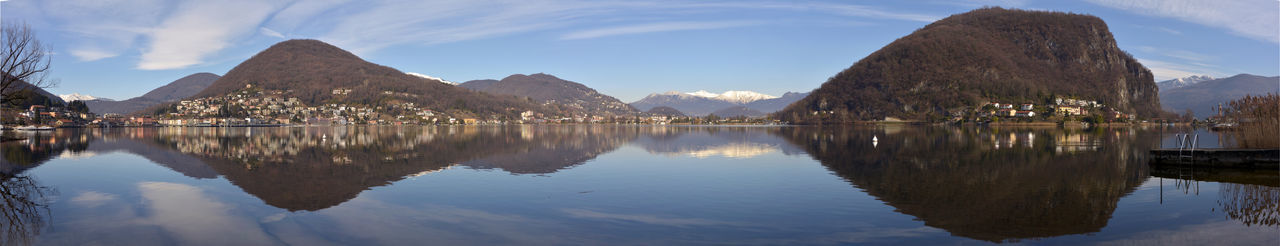 lake of lugano near ponte tresa Lake Of Lugano Panoramic View Sky And Clouds Winter Forest Italy Italy - Swiss Lake Landscape Lavena Ponte Tresa🌼🌞 Mirror Reflection Switzerland Water Water Landscape