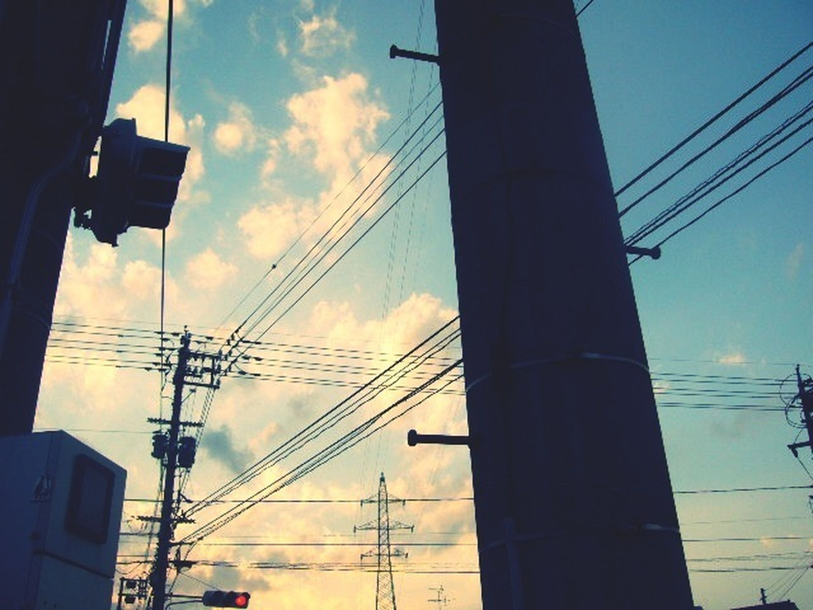 power line, electricity pylon, electricity, power supply, low angle view, cable, sky, connection, fuel and power generation, technology, power cable, built structure, building exterior, silhouette, cloud - sky, architecture, sunset, cloud, cloudy, no people