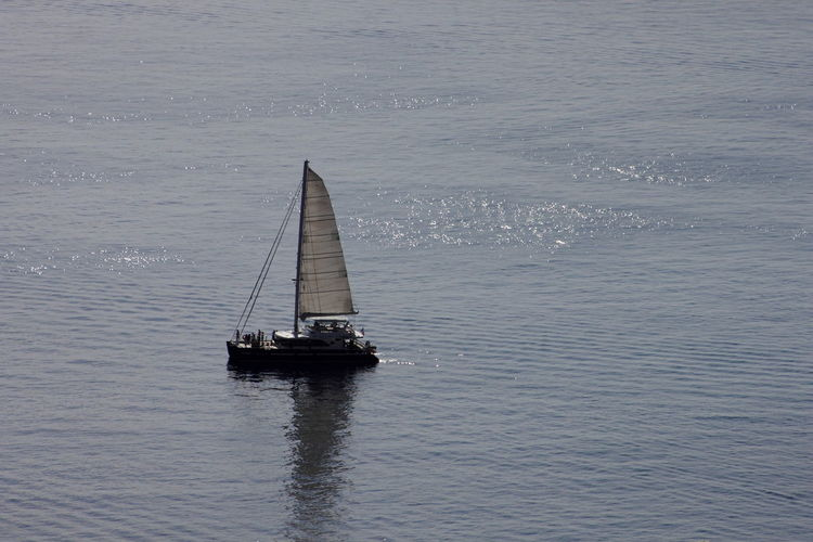 Beauty In Nature Blue Boat Calm Canvas Day Journey Mode Of Transport Nature Nautical Vessel Ocean Outdoors Rippled Sailboat Sailing Scenics Sea Seascape Tranquil Scene Tranquility Transportation Water Waterfront Colors And Patterns