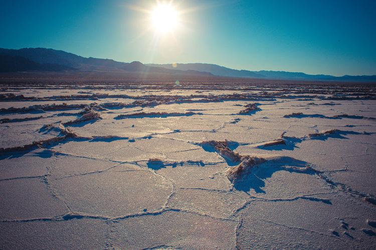 Scenic view of salt desert against clear bright sky