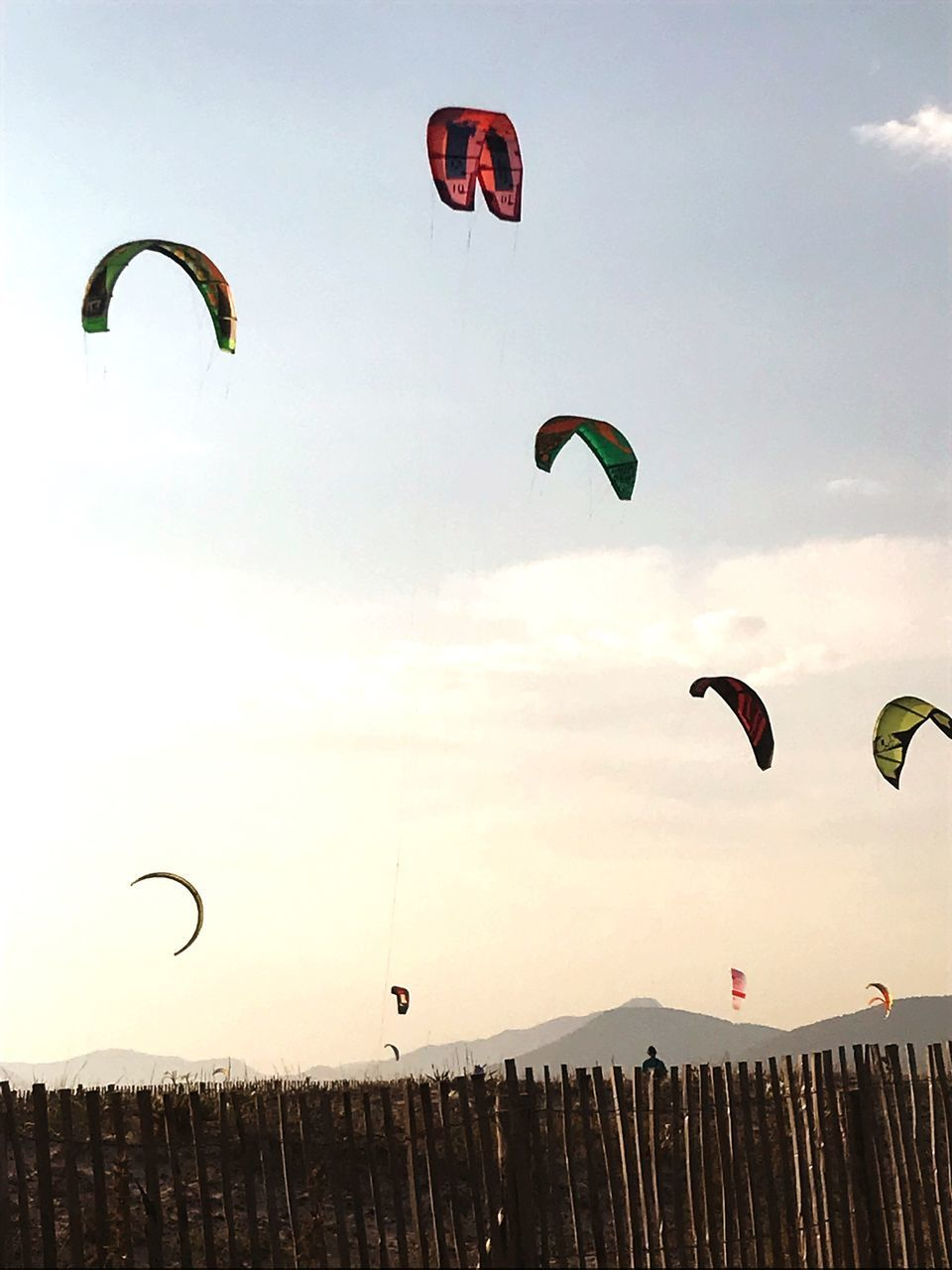adventure, extreme sports, sky, sport, parachute, paragliding, flying, leisure activity, nature, mid-air, low angle view, lifestyles, unrecognizable person, transportation, real people, exhilaration, freedom, beauty in nature, people, group of people, outdoors