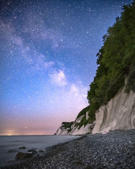 Chalk cliffs Möns Klint at night. Chalk Cliffs Astronomy Beach Beauty In Nature Cliff Dark Sky Park Galaxy Horizon Over Water Island Møn Milky Way Møns Klint Nature Night Outdoors Power In Nature Rock Scenics - Nature Sea Sky Solid Space Star - Space Tranquil Scene Tranquility Water