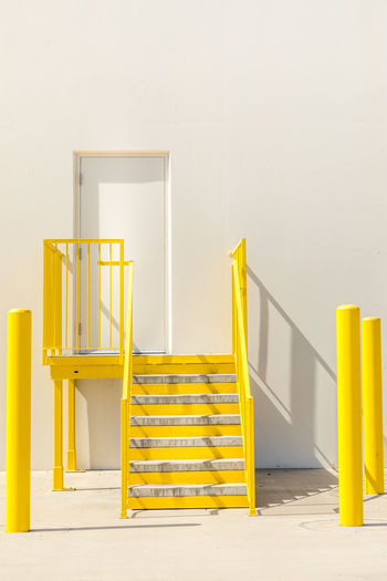 Stairs Absence Architecture Building Built Structure Chair Copy Space Day Empty Flooring Indoors  Ladder No People Railing Safety Seat Security Staircase Steps And Staircases Success Up Wall - Building Feature Wood - Material Yellow
