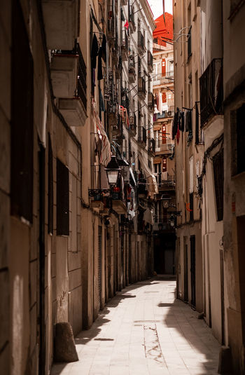 1 of 1.000.000 beautiful narrow alleys you will discover in Barcelona, Spain. Barcelona Catalunya City Old Town SPAIN Alley Architecture Building Building Exterior Built Structure City Day Direction Footpath Fujifilm Fujifilm_xseries Narrow No People Old Oldtown Outdoors Street Street Photography Streetphotography Wall