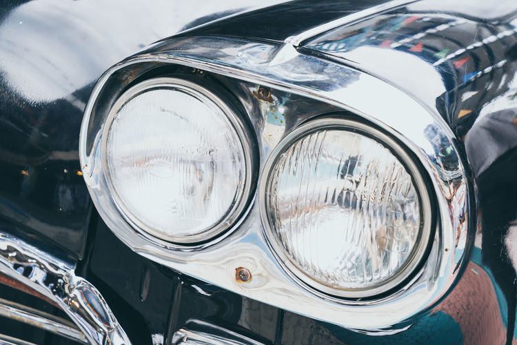 Close-up of vintage car headlights