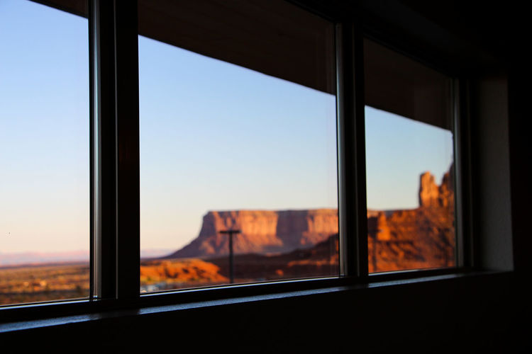 Window Transparent Glass - Material Indoors  Sky Nature Sunset No People Vehicle Interior Architecture Clear Sky Scenics - Nature Day Orange Color Sunlight Built Structure Focus On Foreground Mountain Landscape Window Frame The View Hotel Arizona Desert Arizona Monument Valley