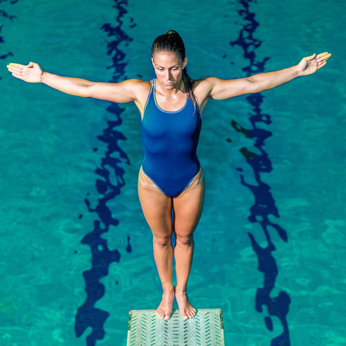 Female Diver Standing On The Jumping Board Diving Diver Swimming Pool Water Sport Woman Jumping Female Jump Wet Diving Board Board Above Action Extreme Sports Swimwear Water Sport Swim Active Training Exercising Muscular One Woman Only Pool Square
