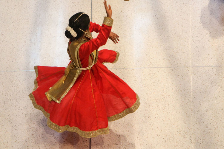 Clothing Red One Person Traditional Clothing Full Length Real People Wall - Building Feature Arts Culture And Entertainment Dancing Performance Human Arm Lifestyles Skill  Women Costume Day Unrecognizable Person Arms Raised Autumn Mood