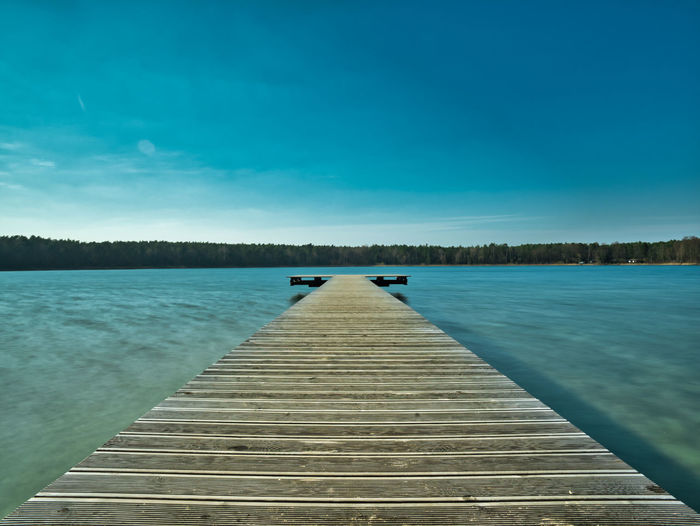 Jetty on a lake in Brandenburg Sky Water Lake The Way Forward Nature Tranquility Pier Blue Direction Beauty In Nature Scenics - Nature Tranquil Scene Day Wood - Material Idyllic Jetty No People Outdoors Tree
