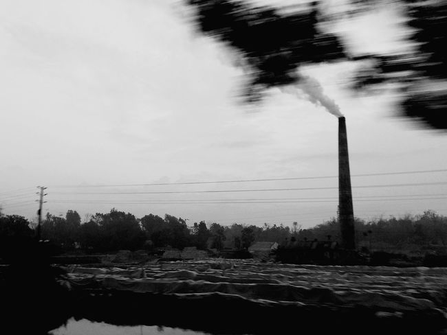 Dawn from a travelling bus Smoke Brick Field Brick Factory High Speed High Speed Photography From A Bus Window Sky Nature No People Traveling Travel Photography Travel B&w Street Photography B&w