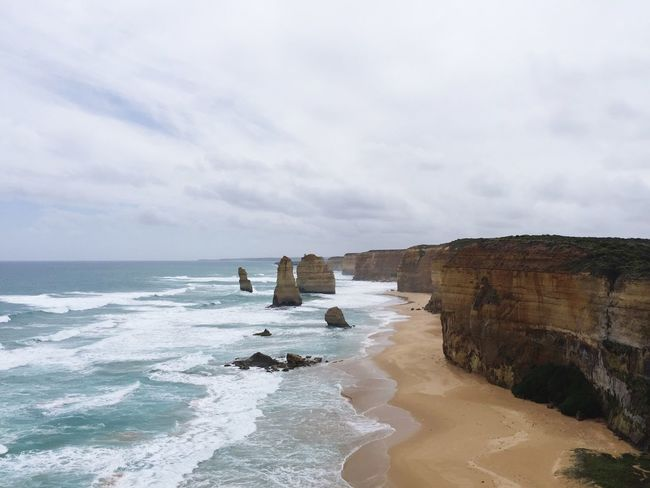 Soaking Up The Sun On The Beach Check This Out great ocean road through Twelveapostles great view and magnificent Places I've Been