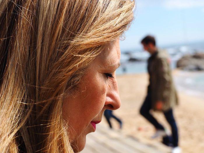 Close-up of mature woman at beach