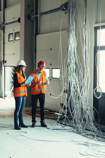 Architects examining cables at site