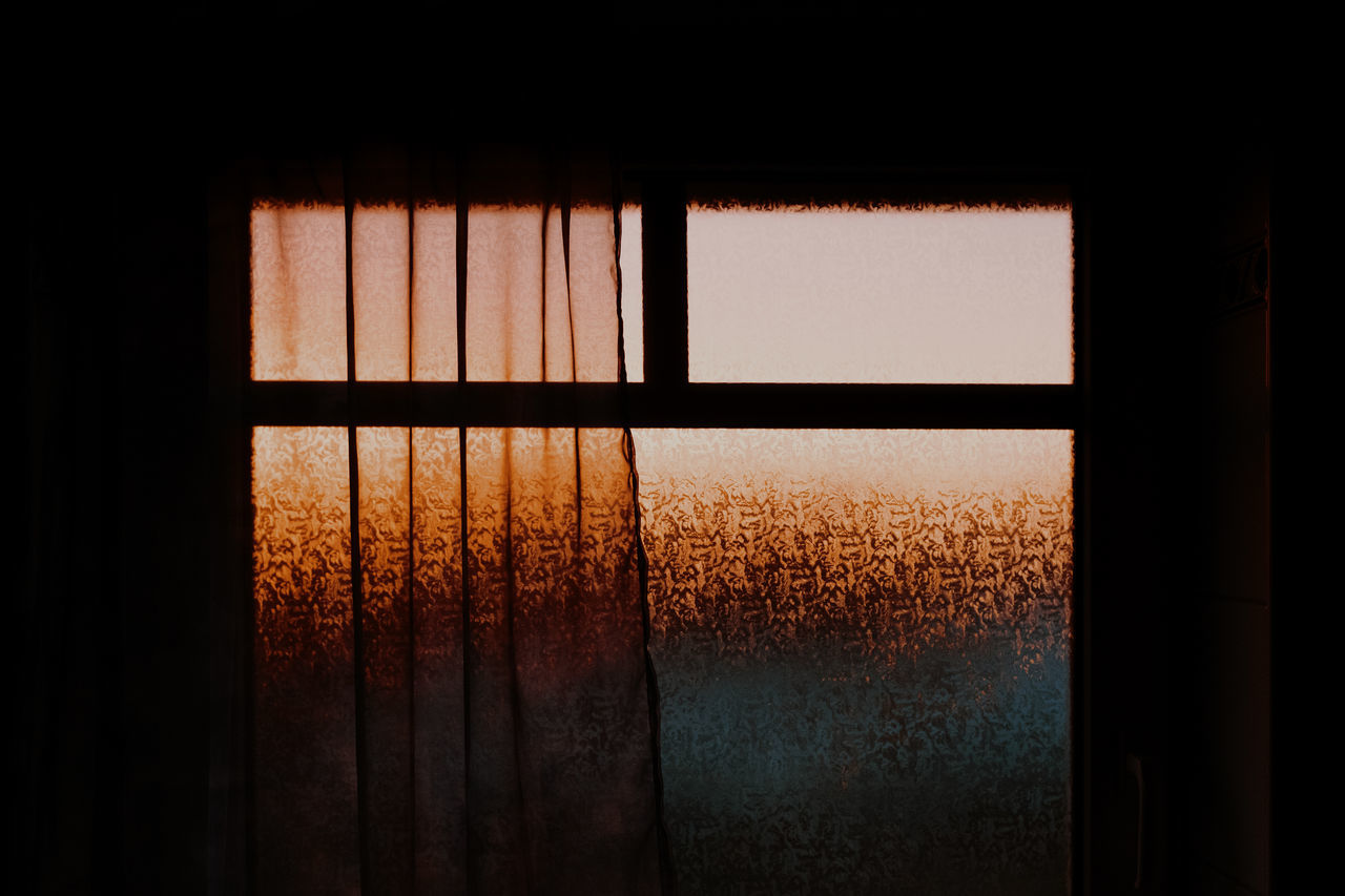 Glass window in house during sunset