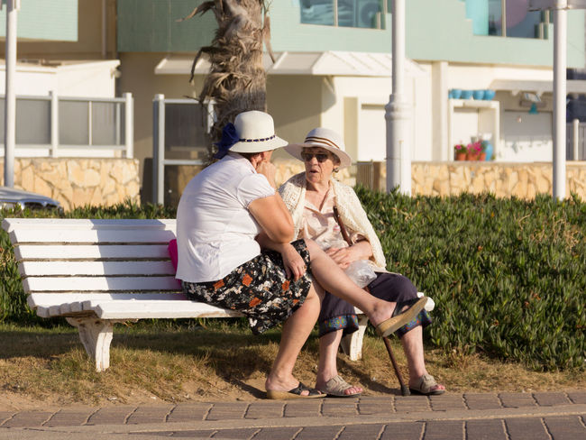 Nahariya, Israel - May 30, 2016: Two elderly women sitting on a bench and talk on the promenade in Nahariya, Israel Discussion Adults Aging Bench City City Life Day Eldery Emotions Females Happiness Israel Lifestyles Nahariya Outdoors People Positive Promenade Real Seniors Sitting Talk Talking Two Women