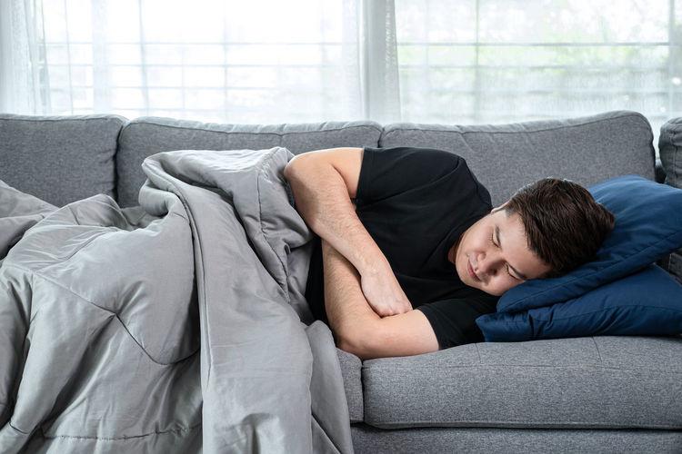 Full length of man lying on sofa