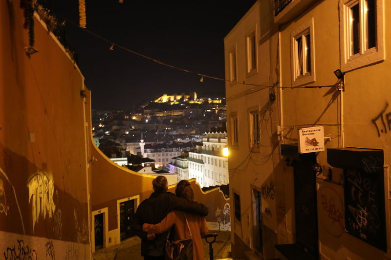 Couple Lisbon - Portugal Love Portugal Travel Travel Photography Architecture Building Building Exterior Built Structure City City Life Cityscape Europe Illuminated Lisbon Night Night View Night View Of City People Real People Residential District Travel Destinations