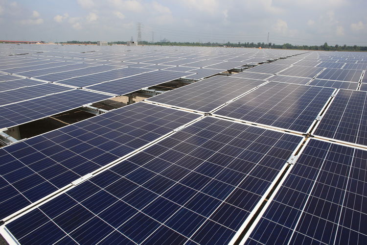 large scale solar farm Alternative Energy Business Economy Electricity  Environment Environmental Conservation Environmental Issues Finance Fuel And Power Generation Industry Nature Outdoors Power Supply Renewable Energy Roof Sky Solar Energy Solar Panel Sun Sunlight Sustainable Resources Technology