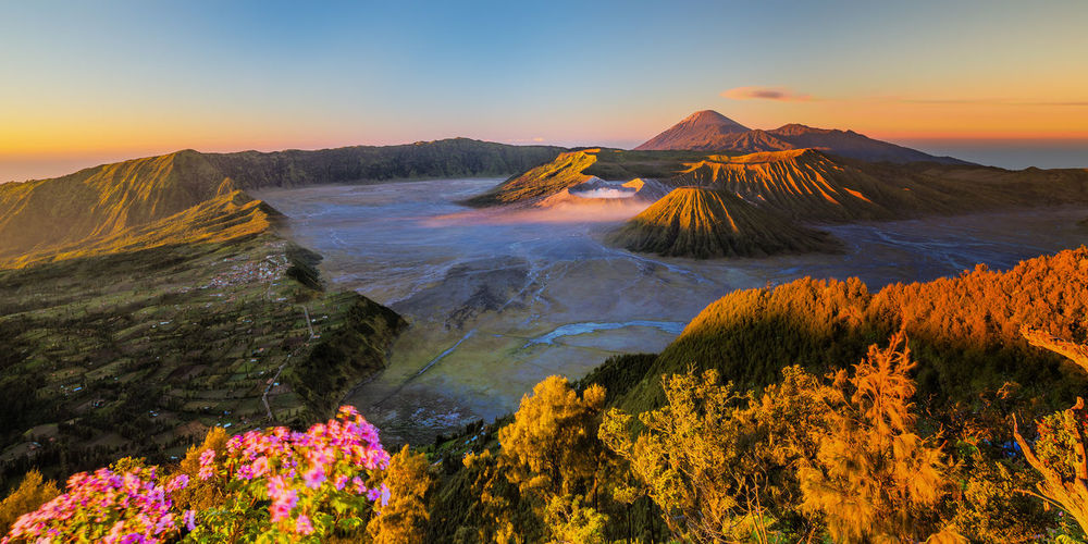 Scenic view of volcanic crater during sunset