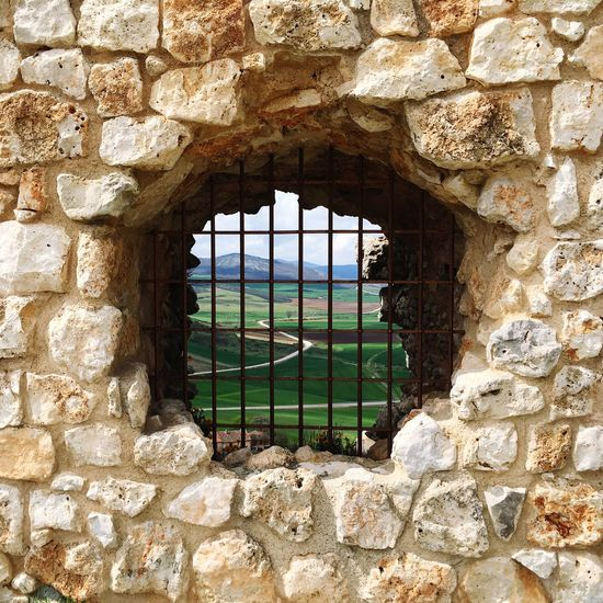 View From The Window Landscape Behindthebars Nature Stones Green Relaxing The Great Outdoors - 2016 EyeEm Awards Window Architecture Built Structure History No People Old Wall - Building Feature Stone Wall Day Wall Stone Material Solid Ancient Security Old Ruin Building