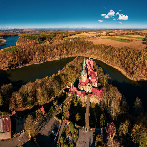 High angle view of church and landscape against sky
