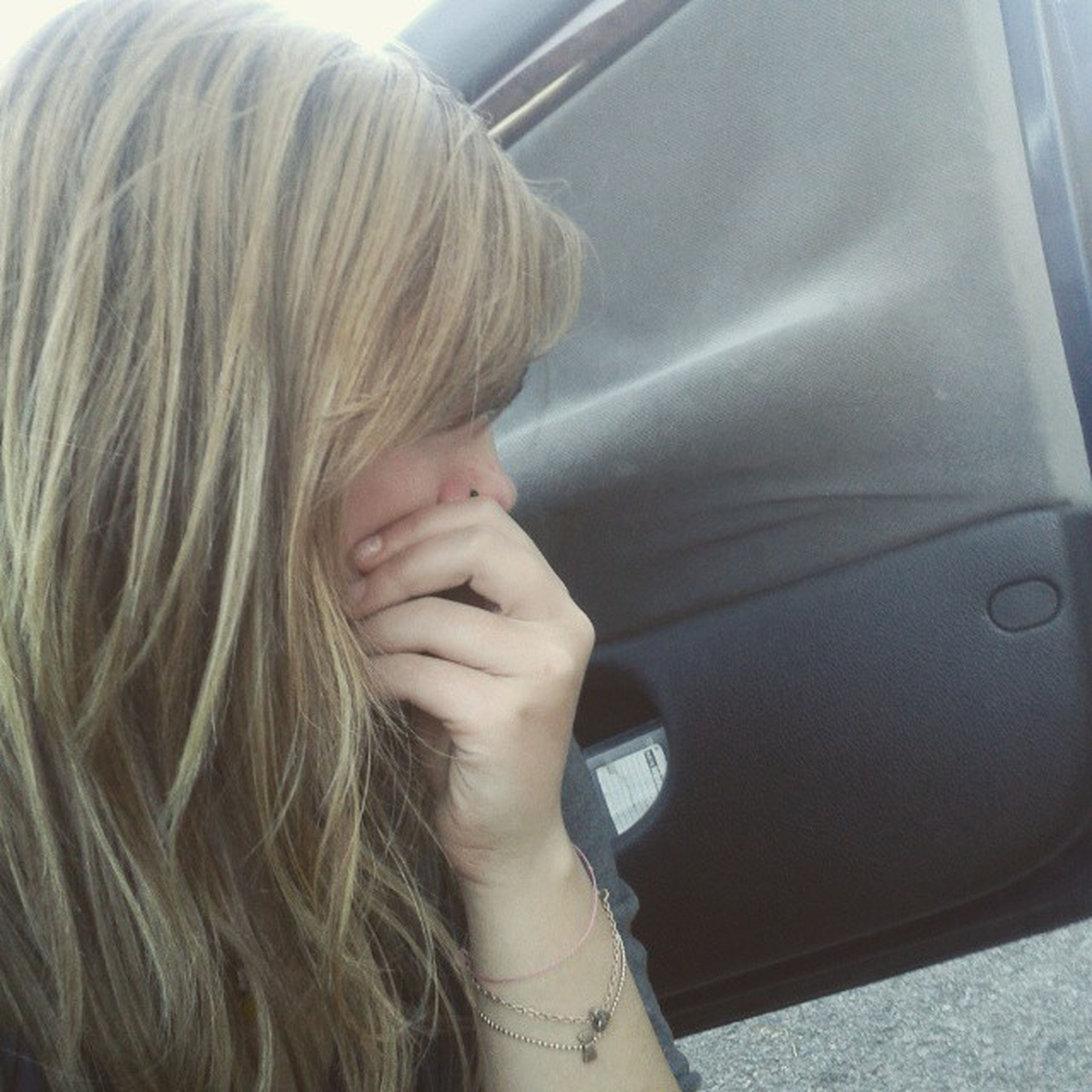 lifestyles, indoors, person, long hair, young women, leisure activity, headshot, young adult, blond hair, close-up, transportation, casual clothing, human hair, vehicle interior, looking away, side view