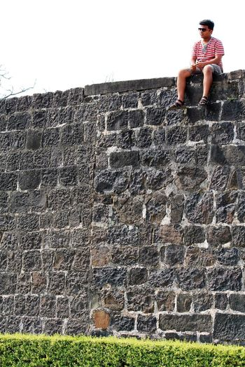 Sitting on High walls is always feel adventerious Ancient Civilization Architecture Backgrounds Brick Wall Built Structure Carefree Damaged Day Escapism Full Frame History Leisure Activity Old Outdoors Pattern Stone Wall Textured  Wall Wall - Building Feature