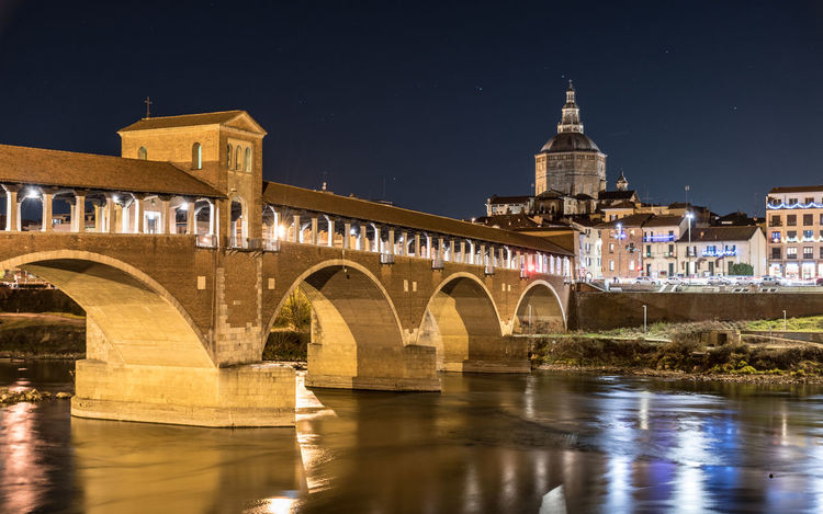 Night view of Pavia with Ponte Coperto and the river Ticino Architecture Cathedral Church City Cityscape Lights Nocturne Pavia Reflection Skyline Arches Bridge Italy Landmark Lombardia Long Exposure Night Ponte Coperto River Sky Stars Ticino Urban Urban Skyline