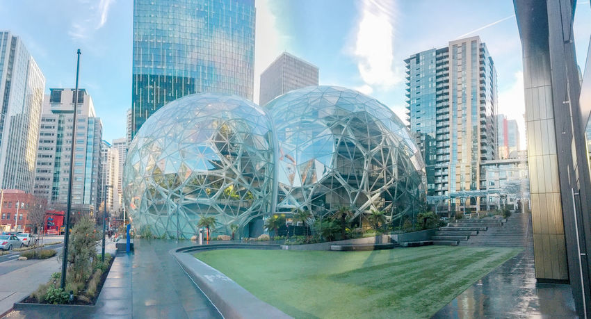 Amazon world headquarters spheres in downtown Seattle circa January 2018. Editorial featuring campus lawn, steps and surrounding towers. Architecture Business Campus Condominiums Downtown Jeff Bezos Offices Seattle Skyline Washington Amazon Design Engineering Finance Green Houses Headquarters Housing Lawn Office Towers Panorama View Real Estate Software Spheres Wealth World