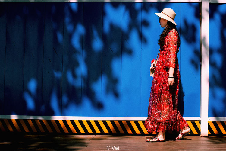 Walking One Person Night Outdoors Women Transportation Adult Real People Blue Road Red Adults Only One Woman Only People Only Women Human Body Part City Sky One Young Woman Only