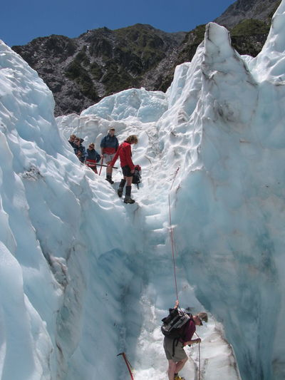 Adult Adults Only Adventure Challenge Climbing Cold Temperature Day Extreme Sports Full Length Headwear Healthy Lifestyle Leisure Activity Mountain Moving Down Outdoors People Ski Holiday Skill  Snow Sport Sports Clothing Sunlight Two People Winter Young Adult