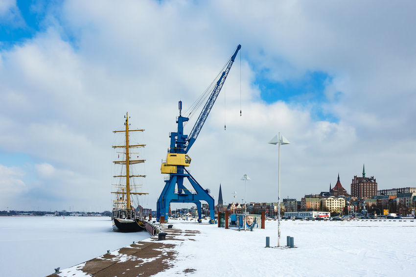Winter time in the city port of Rostock, Germany. Architecture City Frozen Harbor Relaxing Rostock Sailing Ship Travel Winter Buildings Cold Temperature Crane Journey Nature Outdoors Port River Sky Snow Tourism Town Travel Destinations Vacation Warnow Windjammer
