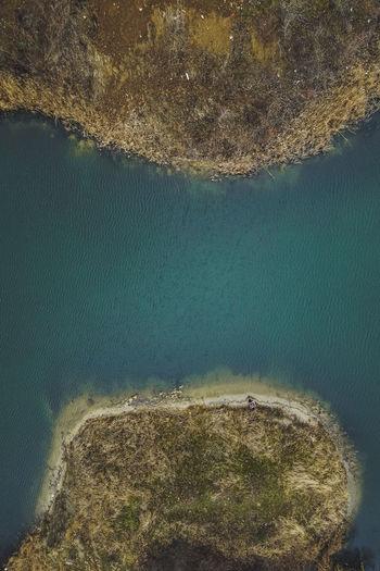 High angle view of sea seen through rocks