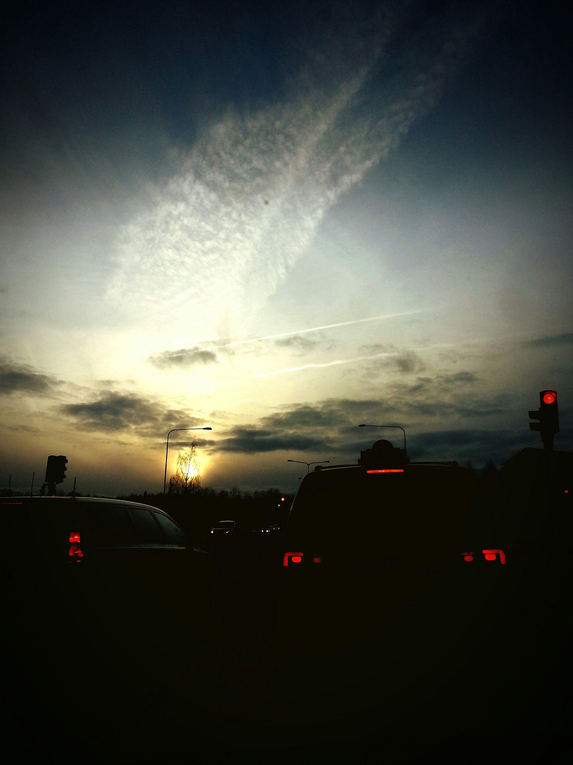 transportation, sunset, sky, car, silhouette, land vehicle, mode of transport, cloud - sky, road, building exterior, street, built structure, nature, dusk, outdoors, street light, architecture, no people, sun, cloud