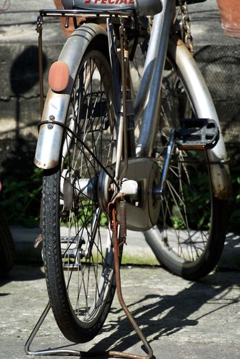 Transportation Mode Of Transportation Bicycle Wheel City Day Street Shadow Land Vehicle Stationary Outdoors Nature Footpath Sunlight Architecture Road No People Tire Sidewalk