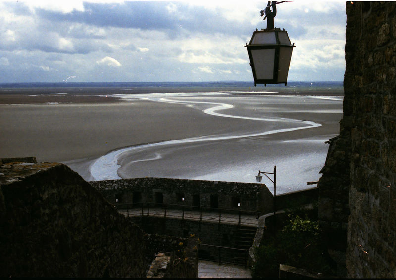 Mont Saint Michel at low tide against sky Mont Saint Michel Bay Beauty In Nature Built Structure Low Tide No People Outdoors Scenics Water