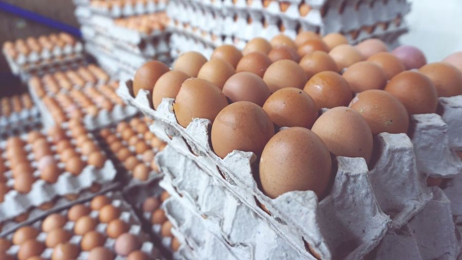 Chicken eggs EyeEm Selects Egg Carton Market Food Staple Fruit Egg Brown Business Finance And Industry Close-up Food And Drink For Sale Price Tag Raw Farmer Market Retail Display Shop