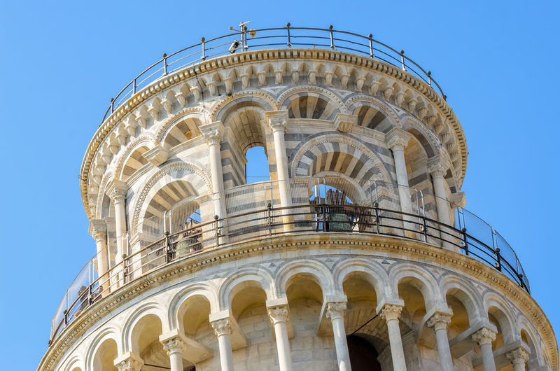 The leaning Tower of Pisa. Italy. Pisa Sunny Top Angle Arch Architecture Blue Building Exterior Built Structure Clear Sky Columns Day Europe History Italian Italy Leaning Ornate Sky Tourism Tower Travel Travel Destinations Warm White Background