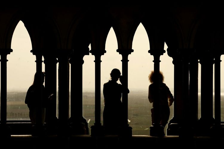 Silhouette people standing in historic building