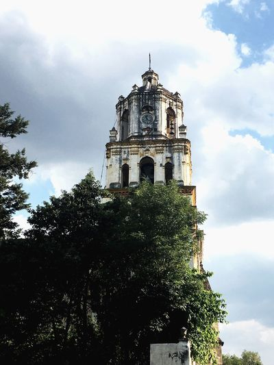 Sky Tree Cloud - Sky Architecture Low Angle View Built Structure Religion Place Of Worship Spirituality Building Exterior History Day No People Outdoors Bell Tower Clock Tower Nature Coyoacán Cdmx
