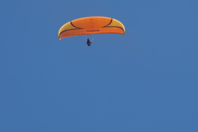 Parachute Copy Space Blue Adventure Low Angle View Clear Sky Leisure Activity Extreme Sports Mid-air Paragliding Day Real People Flying Sport Outdoors Lifestyles Nature One Person People EyeEmNewHere