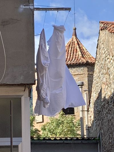 Low angle view of clothes drying against building