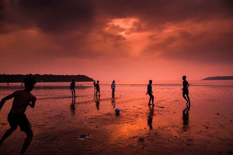 Beach Beauty In Nature Cloud - Sky Day Horizon Over Water Leisure Activity Lifestyles Men Nature Outdoors People Real People Scenics Sea Silhouette Sky Sport Standing Sunset Water